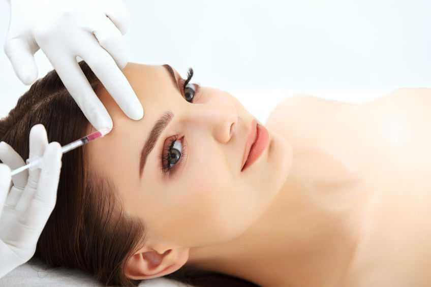 Beautiful woman gets botox injections. Cosmetology. Beauty Face||
