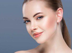 Woman beauty portrait skin care concept on blue background. Studio shot.|